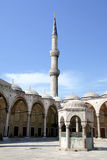 Courtyard, fountain and minaret Royalty Free Stock Photos