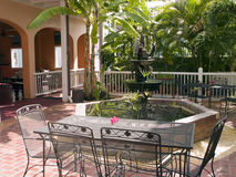 Courtyard Fountain with Tables. Courtyard with a bubbling fountain and seating in restored Danish West Indies town home circa 1765 in Christiansted, St. Croix Stock Images