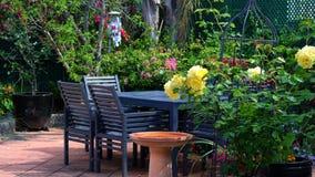 Courtyard garden setting. Beautiful springtime Mediterranean style courtyard garden with outdoor setting Stock Photos