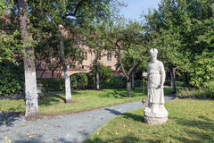Courtyard garden with statue and old historic houses of beguinage in Antwerp, Belgium Royalty Free Stock Image