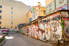 Courtyard with graffiti in St. Petersburg. The walls of buildings in St. Petersburg painted street artists in the style of street art. Colorful graffiti Royalty Free Stock Photos