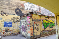 Courtyard with graffiti in St. Petersburg. The walls of buildings in St. Petersburg painted street artists in the style of street art. Colorful graffiti Royalty Free Stock Photo