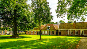 Courtyard with grass and old Oak and Chestnut Trees in the historic village of Midden Beemster Royalty Free Stock Images