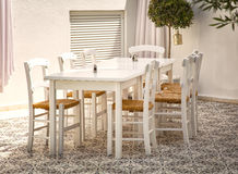 Courtyard in Greece. Image of classic greek table and chairs in a shaded courtyard Stock Photography