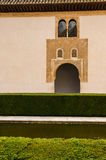 Courtyard in historic Spanish palace with window, water, arch, and tile roof Royalty Free Stock Image