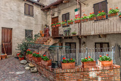 Courtyard, house and balcony with flowers. Royalty Free Stock Photography