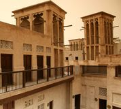 Courtyard houses with wind towers. View of wind towers in old Bastakiya district, Dubai UAE. Traditional courtyard houses and classic wind towers Stock Photo