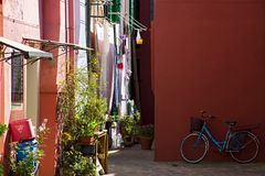 Biking in the courtyard with colorful houses. Stock Image