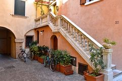 Courtyard in Lake Garda, Italy. Stairs leading up to flat and bicycles outside Stock Image