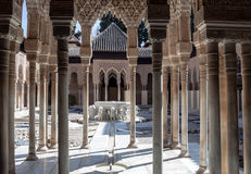 Courtyard of the Lions. Located inside the Nasrid monument of the Alhambra are many columns with a fountain with lions in the center Royalty Free Stock Photography