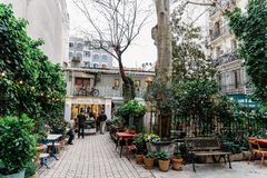 Courtyard with luxury fashion shops. Madrid, Spain - April 7, 2018:  Courtyard with luxury fashion shops near Serrano Street in Madrid in Salamanca District a Royalty Free Stock Images