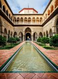 Courtyard of The Maidens, Patio de Doncellas, in the Alcazar Palace, Seville, Andalusia, Spain stock images