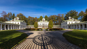 Courtyard of the manor of Serendnikovo with shadow from the gate in the foreground Royalty Free Stock Images