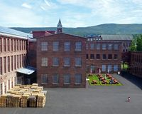 Courtyard, Mass MoCa. Small child runs across courtyard at the Mass MoCa museum of contemporary art in North Adams, Massachusetts. The museum is housed in n a stock image