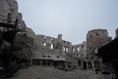 Courtyard of medieval castle ruin in bad weather royalty free stock photography