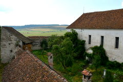 Courtyard of  the medieval fortified saxon church in Ungra, Transylvania Stock Photo