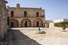 Courtyard at Monastery at Aptera, Crete. View of courtyard at Monastery of St John Theologus at Aptera, Crete .  A peaceful, serene, calm scene Stock Photos