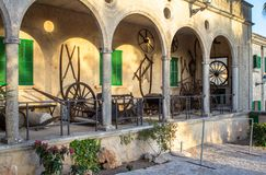 Courtyard of the monastery of Santuari de Cura, at Randa town, M. Medieval broken carts on the courtyard of the monastery of Santuari de Cura, at Randa town Royalty Free Stock Image