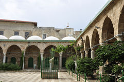 Courtyard of the mosque in Istanbul, Karaköy review with green domes. Courtyard of the mosque in Istanbul Royalty Free Stock Images