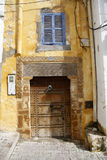 The courtyard. Motorbikes and bicycles in the courtyard of a house in Morocco Stock Photo