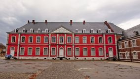 Courtyard with neo classical building of Stavelot abbey on a cloudy day. Courtyard with neoclassical building of the historical Abbey of Stavelot on a cloudy Royalty Free Stock Images