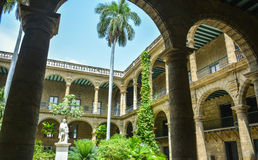 Courtyard in old havana. Havana's courtyard, with palms and arches royalty free stock photography
