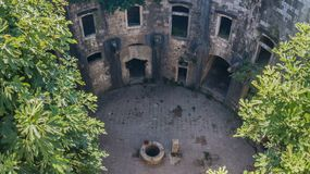 Courtyard of old structure with a stone well Stock Photo