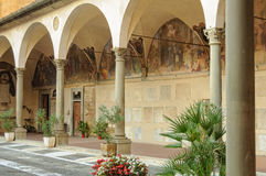 Courtyard of Ospedale degli Innocenti - Florence. Fresco decorated arcade in the courtyard of the Hospital of the Innocents Ospedale delli Innocenti - Florence Stock Photos