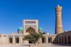 Courtyard at Po-i-Kalyan - Bukhara, Uzbekistan. Courtyard at Po-i-Kalyan, with the madrasa and minaret - Bukhara, Uzbekistan. The complex include Kalyan four Royalty Free Stock Photos