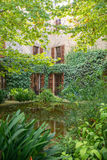 Courtyard with pond and trees. Royalty Free Stock Images