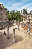 Courtyard with remains of columns. Remains of the ancient Roman civilization was in Spain in Merida, is a vertical image in the background you can see a garden Stock Photo