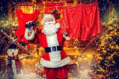 Courtyard of santa claus. Portrait of Santa Claus in the courtyard of his house decorated with Christmas lights. Christmas and New Year concept stock image