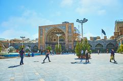The courtyard of Shah`s Mosque, Iran. TEHRAN, IRAN - OCTOBER 11, 2017: The  large courtyard of Shah`s Mosque with fountains, plants in pots and the great portal Royalty Free Stock Photos