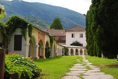 Courtyard of Stadtpfarrkirche St. Andra in Lienz. Lienz, Austria - July 16, 2014. Courtyard of Stadtpfarrkirche St. Andra in Lienz, with footpath, graves and stock images