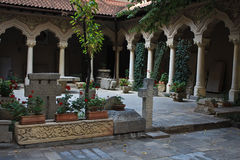 Courtyard of Stavropoleos Monastery. Courtyard with ancient crosses and graves of Stavropoleos Monastery in central Bucharest, Romania Stock Photos
