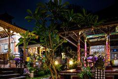 Courtyard terrace of a Buddhist home in southeast Asia shot at night royalty free stock images