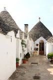 Courtyard of trulli in Alberobello, Italy Stock Image