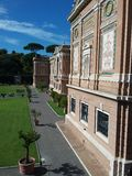 The Courtyard at Vatican museums. Trees in pots and green lawn in the Courtyard of Vatican museums Royalty Free Stock Photos