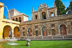 Courtyard with water pool of Alcazar,, Seville, Spain Royalty Free Stock Image
