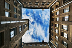The courtyard of the well in St. Petersburg, old architecture of St. Petersburg. Ancient hight courtyards sky round St Royalty Free Stock Photography