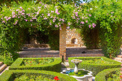 Courtyards and gardens of the famous Palace of the Alcazaba in M Royalty Free Stock Image