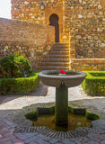 Courtyards and gardens of the famous Palace of the Alcazaba in M Stock Photography