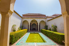 Courtyards and gardens of the famous Palace of the Alcazaba in M royalty free stock photos