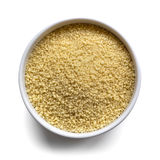 Cous Cous in Bowl over White. Cous cous in a small white bowl,  on white with shadow.  Overhead view Stock Photos
