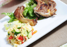 Cous cous with lamb. Cous cous salad with roasted lamb and salad Stock Photos