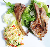 Cous cous with lamb. Cous cous salad with roasted lamb and salad Stock Photography