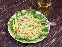 Cous cous salad with salmon. Stock Images