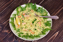 Cous cous salad with salmon. Stock Image