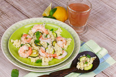 Cous cous salad with shrimps, zucchini and mint. Royalty Free Stock Images