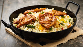 Cous cous with veggies and soy medaillons stock photo